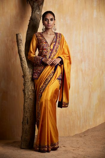Photo of Mustard Saree with Long Embroidered Blouse and Border