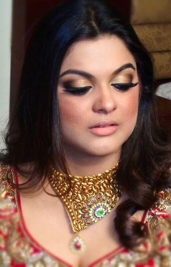 bronze smokey eye bridal makeup with nude lips