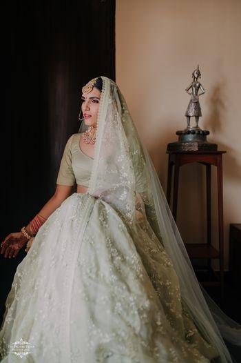 Bride wearing a pale green lehenga
