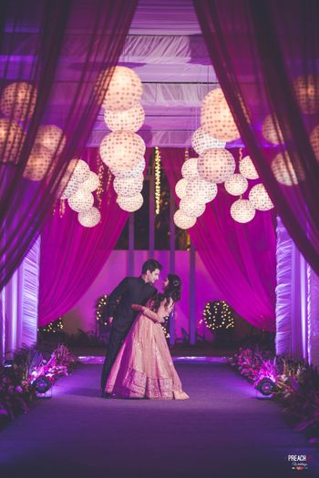 Purple Entrance Decor with Drapes and Round Paper Lamps