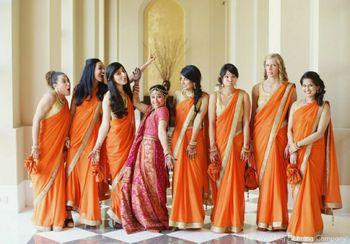 Matching Bridesmaids in Orange Sarees Fun Photo