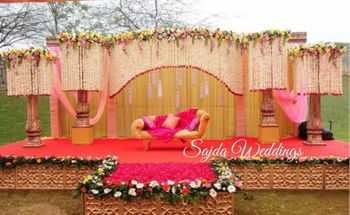 Photo of stage backdrop in pink and peach and gold