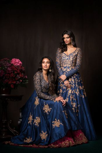 Blue and gold reception outfits by Shyamal Bhumika