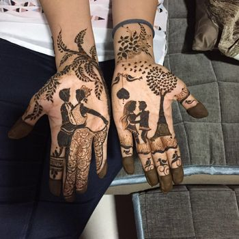 Photo of Mehendi Design with Romantic Couple Portraits