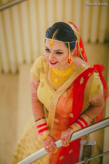 North Eastern Bride in Red and Beige Outfit