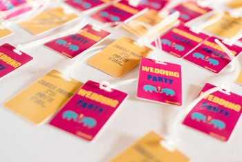 Photo of Wedding Party Tags with Motifs for Destination Wedding