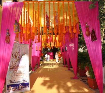 orange and pink rajasthani bhaat ceremony decor