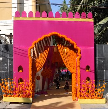 Photo of magenta hot pink and orange rajasthani bhaat ceremony decor