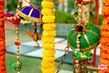 Hanging floral string and small umbrellas mehendi decor