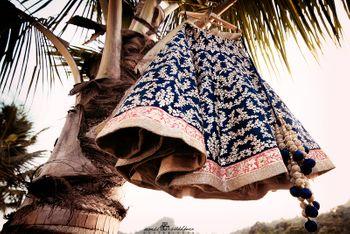 Blue and Pink Bridal Lehenga on Hanger on Tree