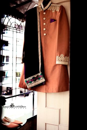 Brown Sherwani on Hanger with Black Shawl