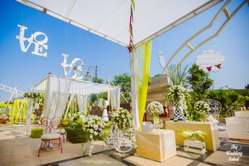 Summery Decor with Monograms and Floral Arrangements