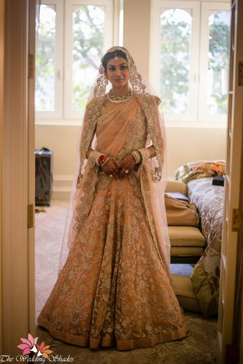 Bridal lehenga in peach and silver