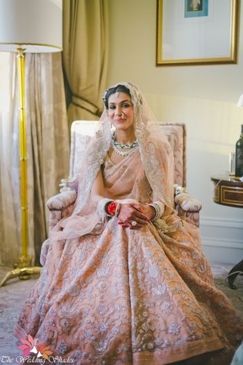 Peach and gold pastel bridal lehenga