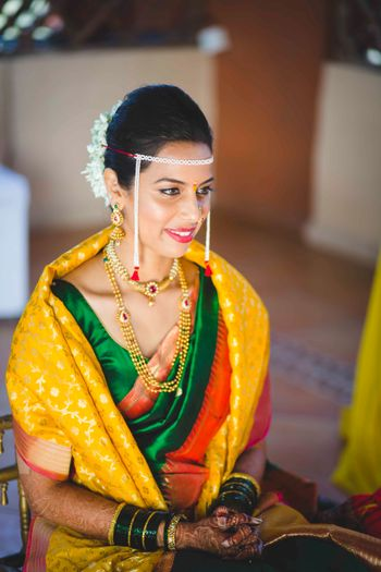 Marathi Bride in Yellow Green and Red Saree
