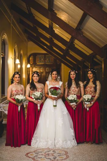 Bride with Matching Bridesmaids in Magenta Dresses