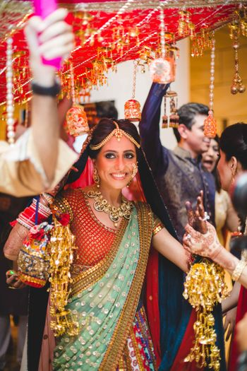 Happy Bride Under Phoolon Ki Chadar