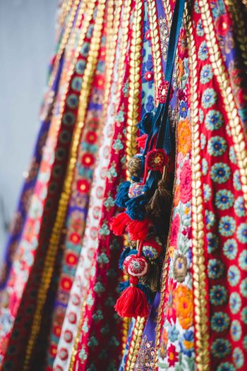 Red and blue threadwork lehenga