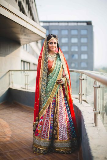 Photo of Sabyasachi multicolored bridal leheng