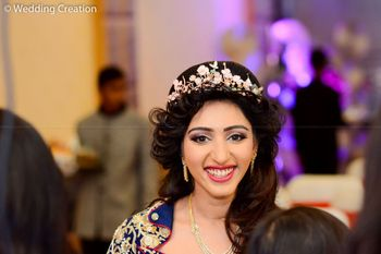 Open hairstyle with studded hair wreath for sangeet