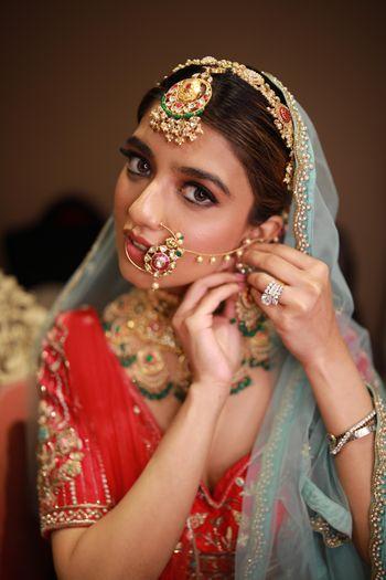 Photo of Getting ready bridal shot.