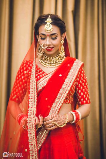 Photo of Minimal bridal lehenga with bride in red
