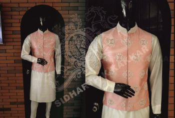 peach waistcoat with embellishment worn over white kurta