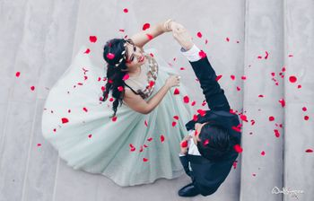Couple dancing shot with rose petals being showered