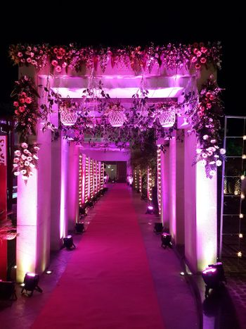 floral archway purple lighting