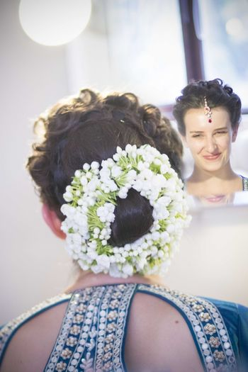 Photo of Bridal Bun with Brided Crown and Flowers
