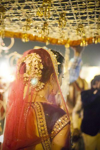 Photo of Bride Entering Under Phoolon ki Chadar with Kaleere