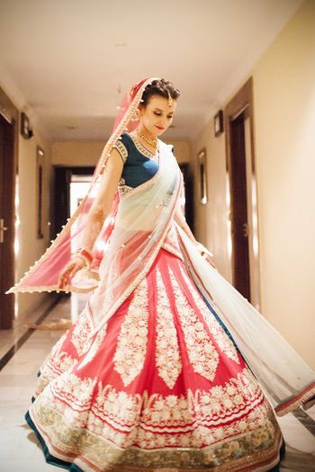 Photo of Red and White Bridal Lehenga with Blue Blouse