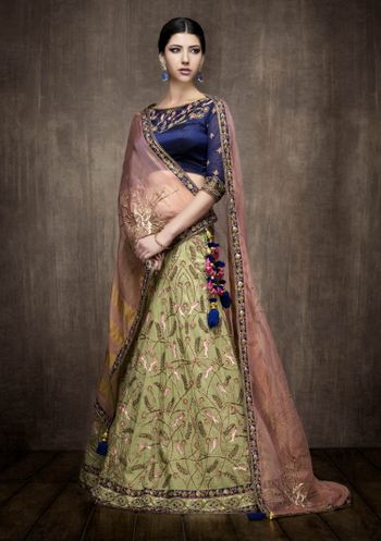 Green Lehenga with Purple Blouse and Pink Dupatta