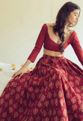 red batik printed cotton lehenga with full sleeves and scoop deep necklines
