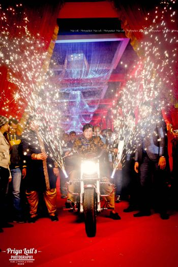 Photo of Groom Entering on Bike with Cold Pyros
