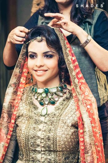 Bride with chunky green uncut diamond necklace