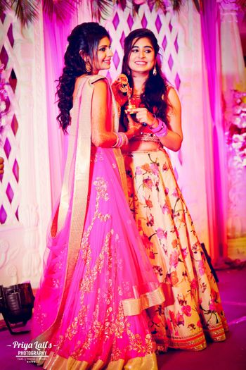 Photo of Bright pink and light pink floral lehengas