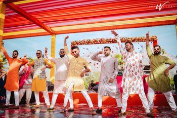 Photo of Groomsmen dancing on Mehendi