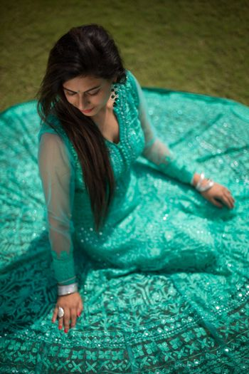 Bride in Flared Teal Net Anarkali