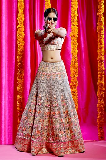 Light grey and red lehenga with bead work and sequins