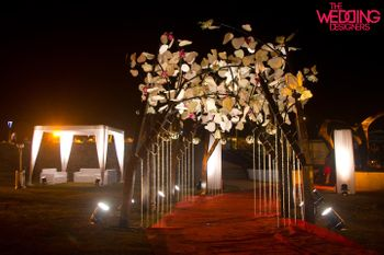 Photo of Entrance tree of life decor at night made from all white paper flowers
