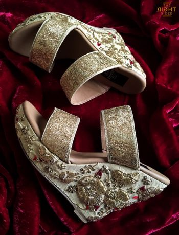 Photo of Dull gold high wedges with zardozi work on heel