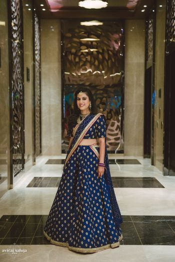 Navy blue lehenga with gold motifs and border