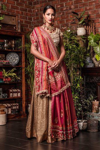 Red and gold saree draped as lehenga
