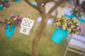 Hanging planters with floral arrangements