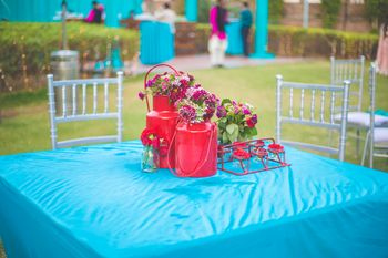 Blue and pink quirky table setting with kettle