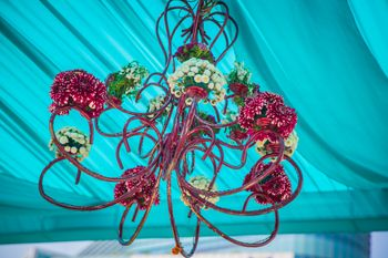 Blue tent with floral pink chandelier