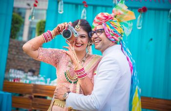 Couple portrait with bride holding camera
