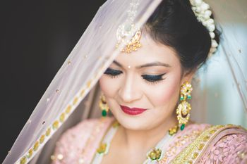 Gold and green bridal jewellery
