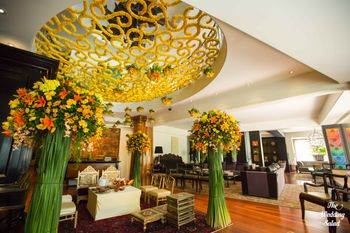 Giant floral vases and a genda flower lattice work ceiling
